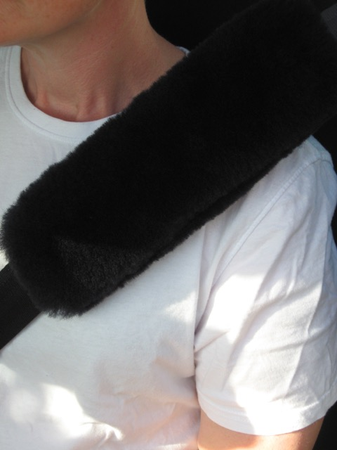 Black sheepskin seat belt cover