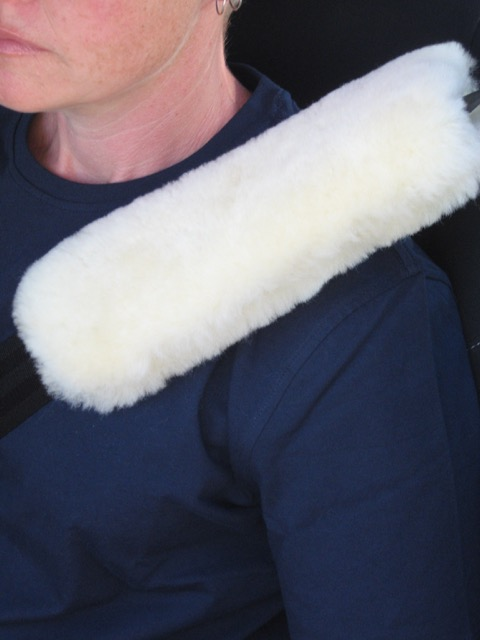 Cream sheepskin seat belt cover
